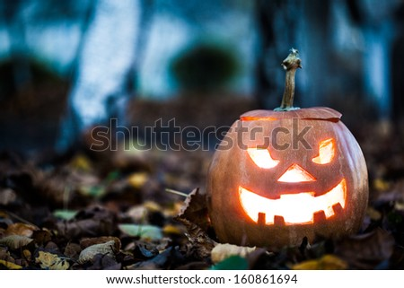 halloween jack-o-lantern on autumn leaves - stock photo