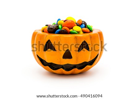 Halloween Jack o Lantern pail overflowing with colorful chocolate