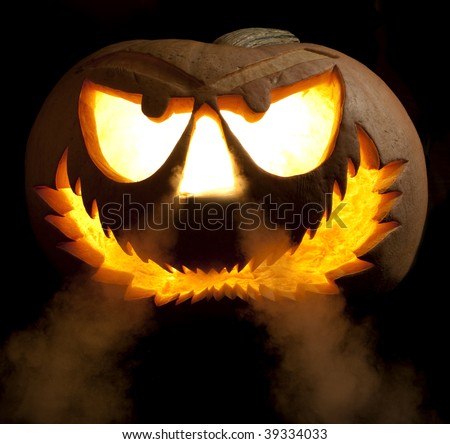 Halloween jack o' lantern with smoke coming from nose on black background