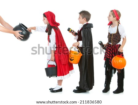Halloween: Kids In Line To Trick Or Treat For Candy - stock photo