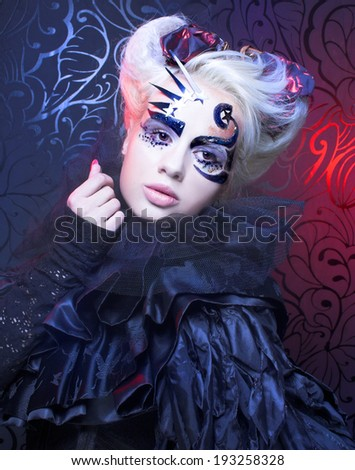 Halloween lady in black. Young woman in creative magic image. - stock photo