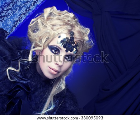 Halloween Lady.Stylish blond woman in dark dress  with artistic visage