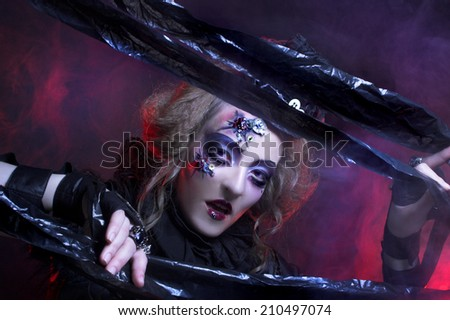 Halloween lady.. Young woman in holiday image of mystery gothic doll. - stock photo