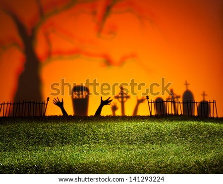 Halloween landscape with tree graveyard and green grass - stock photo