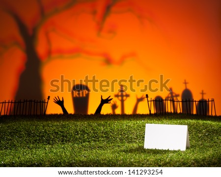 Halloween landscape with tree graveyard and name card - stock photo