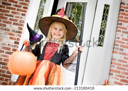 Halloween: Little Girl Witch Ready For Trick Or Treat - stock photo