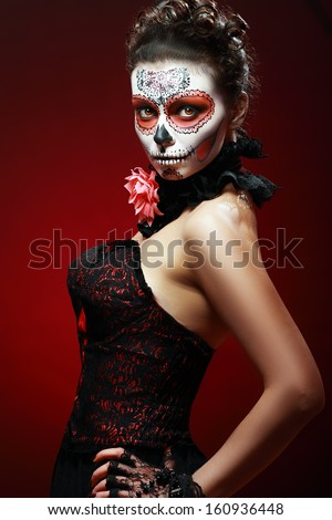 halloween make up sugar skull beautiful model with perfect hairstyle. Santa Muerte concept. - stock photo