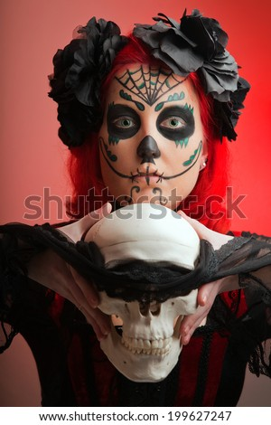 halloween make up sugar skull beautiful model with perfect hairstyle. Santa Muerte concept.