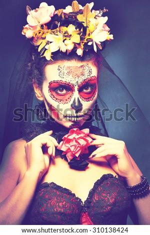 halloween make up sugar skull beautiful model with perfect hairstyle. Santa Muerte concept. Fashion retro toning. - stock photo