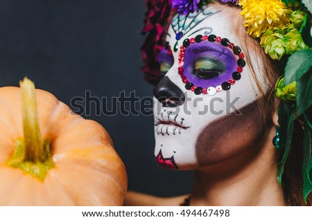 halloween make up sugar skull beautiful model with perfect hairstyle. Santa Muerte concept. Fashion retro toning.