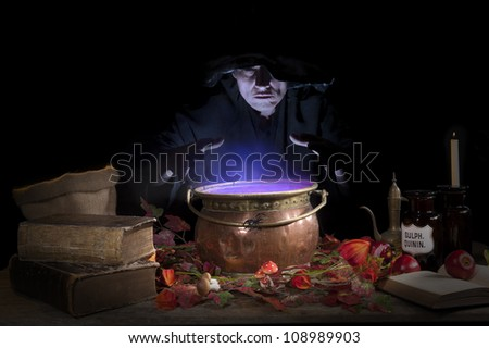 halloween making a potion in a copper cauldron