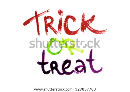 """Halloween motto """"Trick or treat"""" written in watercolors on white isolated background"""