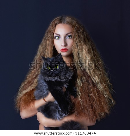 halloween mysterious girl with black cat.beautiful young witch woman - stock photo