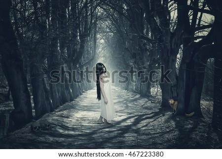 Halloween mystical forest with ghost on the road