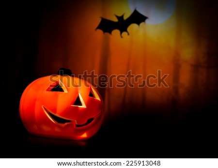 Halloween night background with scary bat and pumpkin, halloween party concept - stock photo