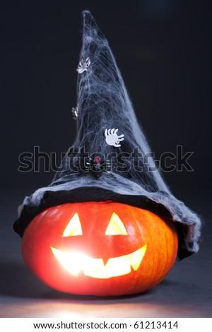 halloween orange pumpkin with witch hat over dark background - stock photo
