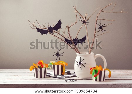 Halloween party decorations with spiders and candy - stock photo