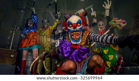 Halloween party scary clowns. - stock photo