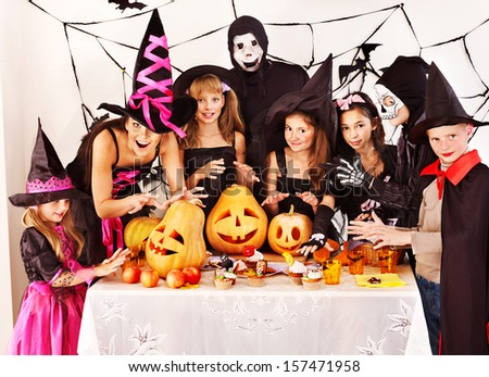 Halloween party with children holding carving pumpkin - stock photo