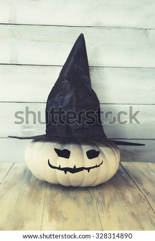 Halloween photo of pumpkin with witch hat - stock photo