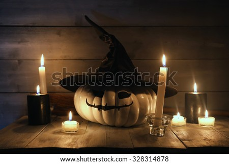 Halloween photo with white pumpkin and candles - stock photo