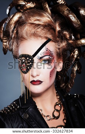 Halloween Pirate Woman portrait. Beautiful Glamour Fashion Sexy Lady with long red hair, beauty make up and costume