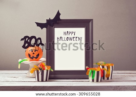 Halloween poster mock up template with candy - stock photo