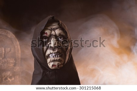 Halloween prop of a scary figure with a smoke background - stock photo