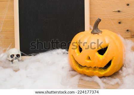 Halloween pumpkin and skulls - stock photo