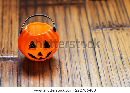 Halloween pumpkin background on wooden with a spider - stock photo