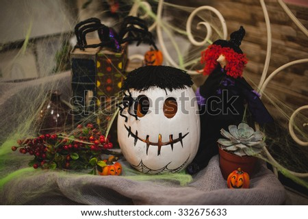 Halloween pumpkin composition with decor, spiders and net
