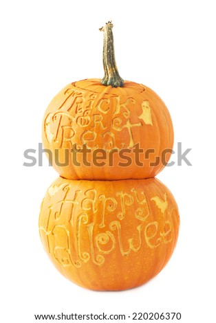 Halloween pumpkin composition with one Trick or Treat pumpkin placed over the Happy Halloween pumpkin, composition isolated over the white background - stock photo