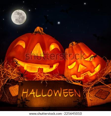 Halloween pumpkin decoration on night sky background, full moon, invitation on festive party, jack-o-lantern, horror concept - stock photo