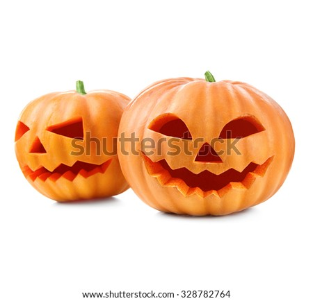 Halloween pumpkin head jack lantern with burning candles isolated on white background. Halloween holidays art design, celebration. Carved Halloween Pumpkins