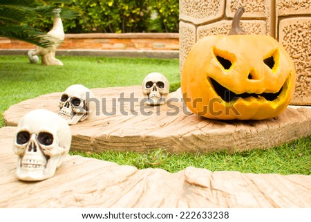 Halloween pumpkin in front of a well - stock photo