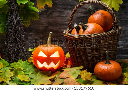 Halloween pumpkin in wicker basket - stock photo