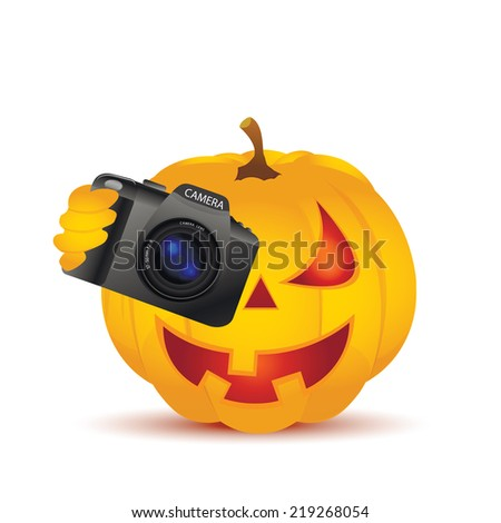Halloween Pumpkin isolated on white and SLR camera - stock photo