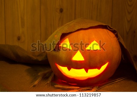 Halloween pumpkin on the table in a rustic barn