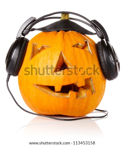 Halloween Pumpkin.Scary Jack O'Lantern in headphones isolated on white background - stock photo