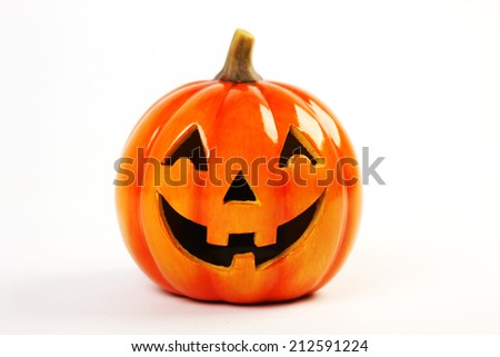 Halloween Pumpkin standing on white background - stock photo