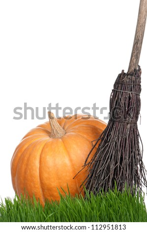 Halloween pumpkin with black hat and broom isolated on white background
