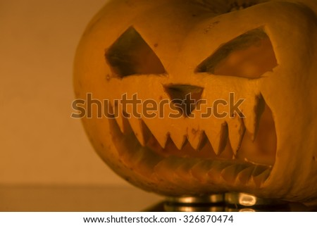 Halloween pumpkin with candlelight and reflection. Shallow depth of field - stock photo