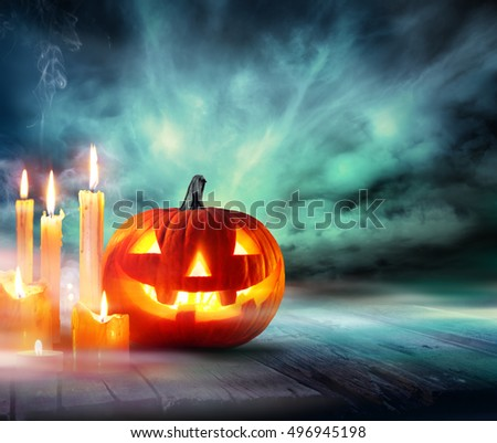 Halloween - Pumpkin With Candles In The Misty Night