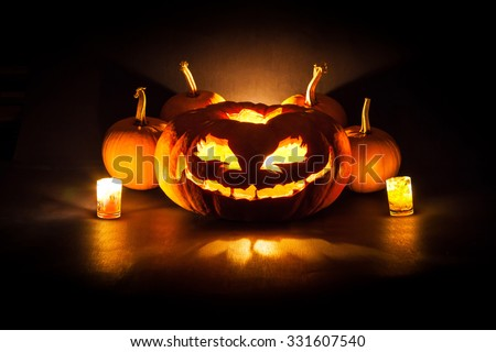 Halloween pumpkin with  candles on a black background - stock photo