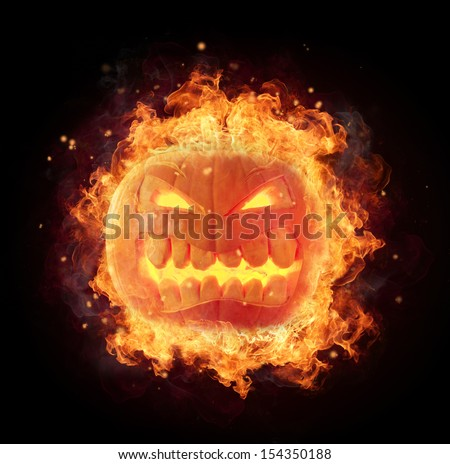 Halloween pumpkin with fire flames isolated on black background - stock photo