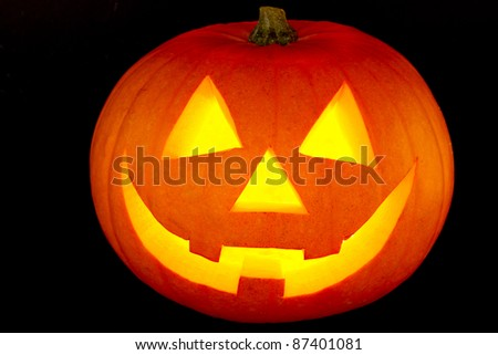 Halloween pumpkin with scary face isolated on black