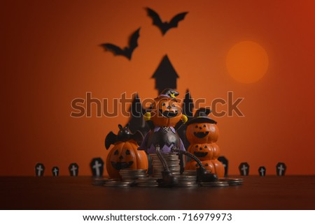 halloween pumpkins jack o lantern with money coin stack growing business on orange background - Growing Halloween Pumpkins