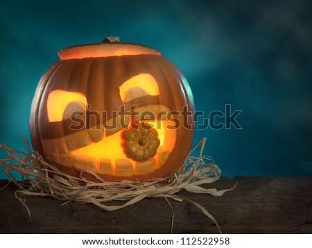 Halloween pumpkins on a wooden desk - stock photo