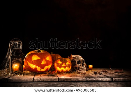 Halloween Pumpkins on old wooden table, still-life.