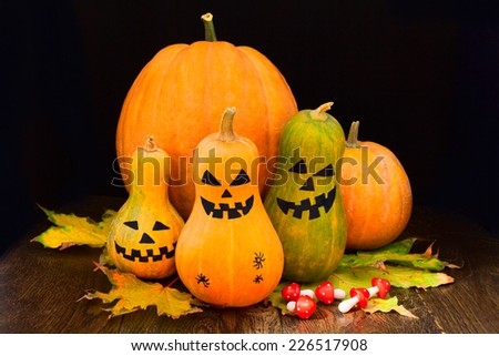 Halloween pumpkins still life with mushrooms and leaves